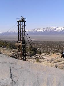 Taylor shaft head frame, Schell Creek Range, NV. Across the valley is the snowy Egan Range
