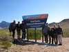 Our Group poses at Gold Butte sign