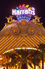 The Harrah's Casino sign on The Strip illuminated at night in Las Vegas, Nevada, USA.