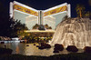 The Mirage Hotel and Casino with a decorative waterfall on The Strip in Las Vegas, Nevada, USA.