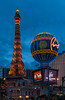 The Paris Hotel, Eiffel Tower and fountains illuminated at night in Las Vegas, Nevada, USA.