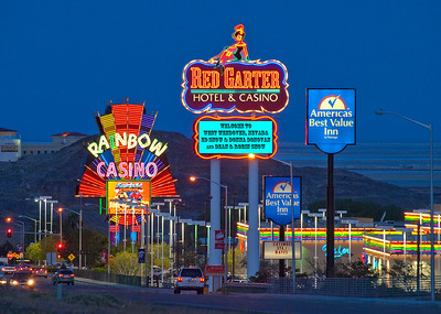Neon signs in West Wendover, Nevada.  Notice the special welcome under the Red Garter sign.