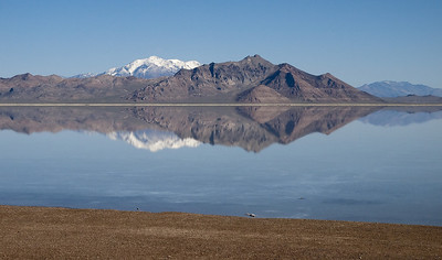 Bonneville Salt Flats. The Silver Island Mountain Range is in the foreground and snow covered Pilot Peak is in the back ground.