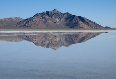 Bonneville Salt Flats.  Silver Island Mountains are reflected in the water.