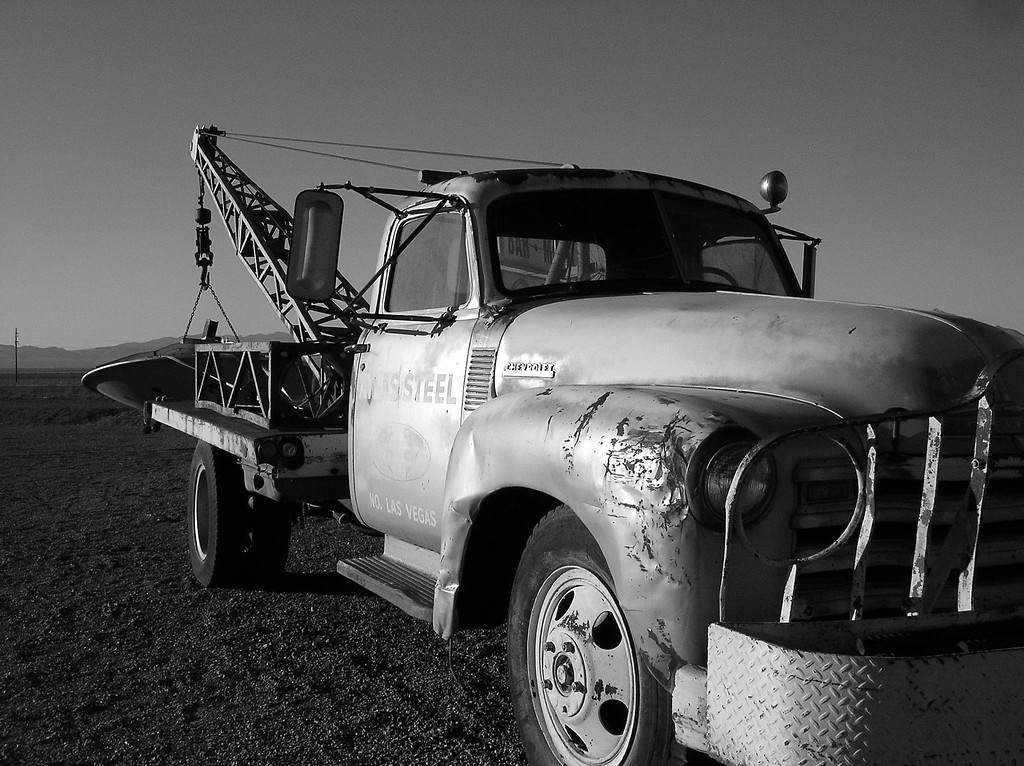 Old truck towing spaceship