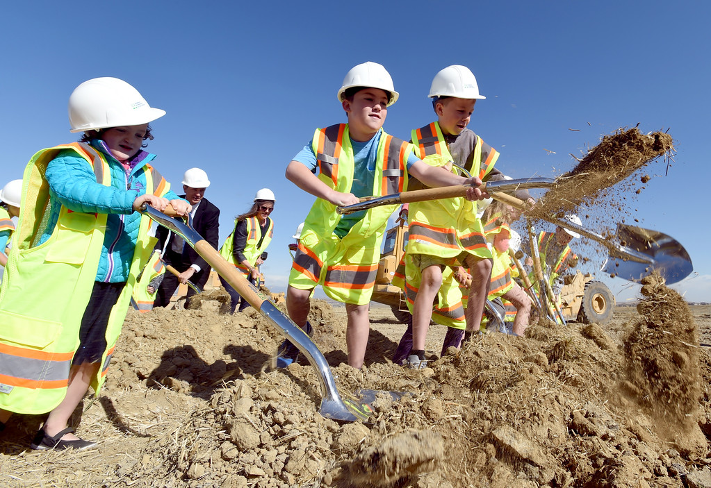 . Ashlyn Devine, left, Mason Smedley, and Owen Bacon, were among the dignitaries to dig during the Anthem P-8 school groundbreaking in Broomfield on Wednesday. For more photos, go to www.dailycamera.com. Cliff Grassmick  Staff Photographer April 19, 2017