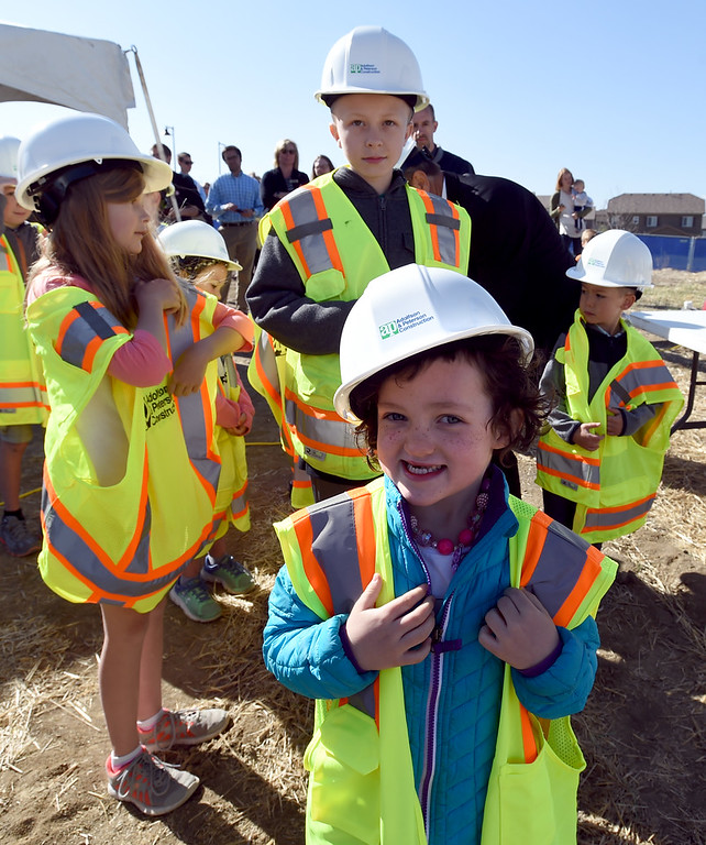. Ashlyn Devine, 5, appears to like her new construction worker look  during the Anthem P-8 school groundbreaking in Broomfield on Wednesday. For more photos, go to www.dailycamera.com. Cliff Grassmick  Staff Photographer April 19, 2017