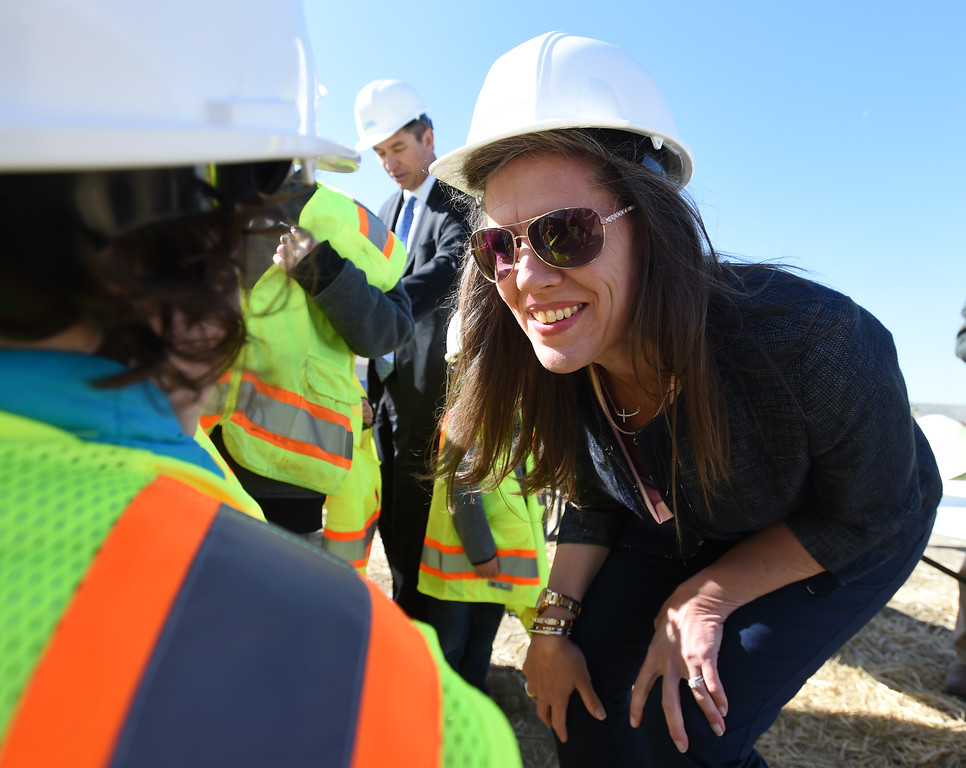 . New school principal, Teresa Benallo, introduces herself to Ashlyn Devine, 5,  during the Anthem P-8 school groundbreaking in Broomfield on Wednesday. For more photos, go to www.dailycamera.com. Cliff Grassmick  Staff Photographer April 19, 2017