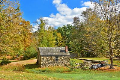 Historic Blacksmith Shop in Autumn Landscape