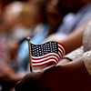 New US citizens hold small American Flags after being sworn in. SUN/David H. Brow