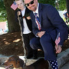 Now he is a real American, showing his patriotic socks and tie is Daniel Higgins 35 of Stoughton, along with his son Joey Higgins 4, and their dog Max, after he received his US Citizenship (he immagrated from Ireland). SUN/David H. Brow