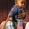 Little Chibudom Eze 1 year old, is held up by his dad Simon Eze, of Revere, right before(Simon) is  sworn in as a US Citizen at LMA on 4th of July. SUN/David H. Brow