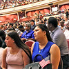 Holding her small American Flag waiting to be sworn in as a US Citizen is on right, Thuy Phan 47 of Malden, next to her daughter Julie Hernandez 18. SUN/David H. Brow