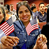 Ready to become proud American citizens at LMA is L-R, Norma Lopez, and sisters Dariany Marte and Marianny Marte, all from Lynn. SUN/David H. Brow