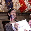 Robin Cho of Watertown shows her certificate as a US Citizen. SUN/David H. Brow