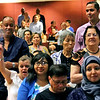 New US Citizens wave their American Flags after being sworn in. SUN/David H. Brow