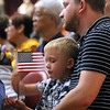 New US citizen Paul Maroz of Stoneham and org., from Belarus, with his son Nikita Maroz 5. SUN/David H. Brow