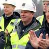 The Town of Billerica held a groundbreaking ceremony for the new Billerica Memorial High School on Monday afternoon. The new school is being built in the fields behind the old one. Jim McKenna with Shawmut, the general contractors for the project, listens to the speakers a the ceremony. SUN/JOHN LOVE