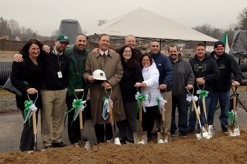 The Town of Billerica held a groundbreaking ceremony for the new Billerica Memorial High School on Monday afternoon. The new school is being built in the fields behind the old one. Faculty of the High School pose for a picture during the throwing of the dirt part of the ceremony. SUN/JOHN LOVE