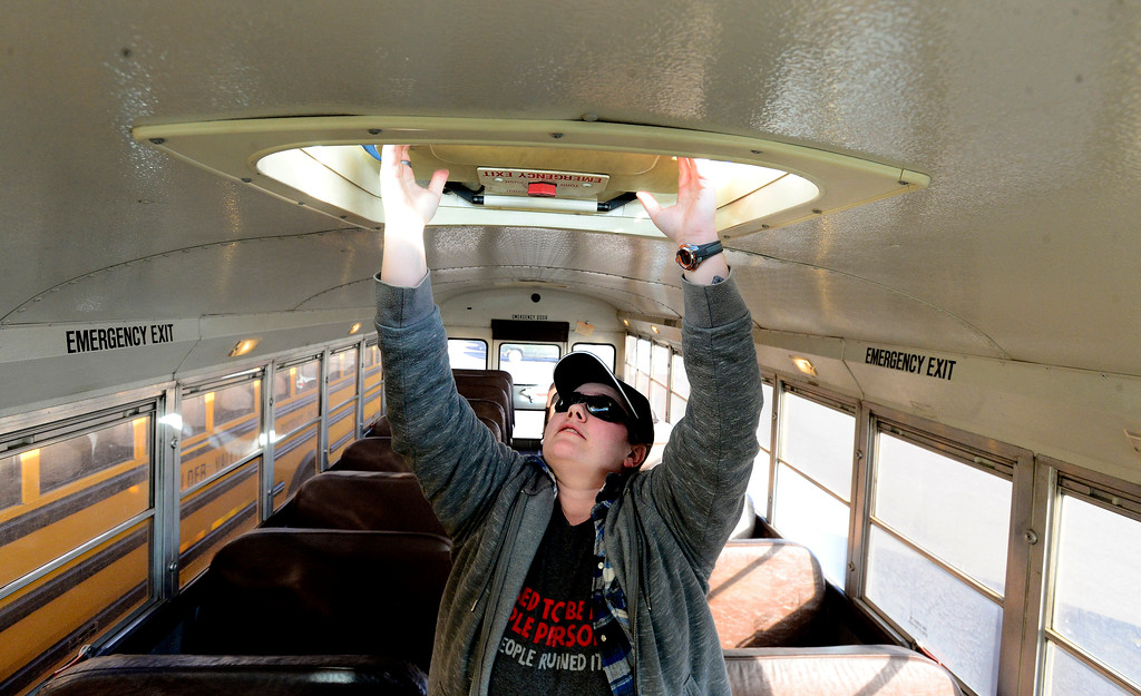 . BOULDER, CO - JANUARY 8, 2019 Driver Mellissa Gerard checks the emergency exits of her bus before starting her route at the BVSD Transportation Center Boulder Terminal on Tuesday afternoon January 8, 2019.  (Photo by Paul Aiken/Staff Photographer)