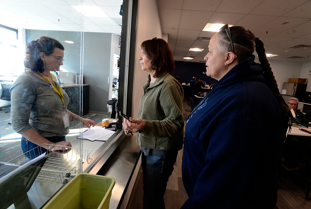 . BOULDER, CO - JANUARY 8, 2019  Dispatcher/Helper Jennifer Donnelly, left, checks out drivers Judy Sanchez and Michelle Coates, right,  prior to going out on their routes at the BVSD Transportation Center Boulder Terminal on Tuesday afternoon January 8, 2019.  (Photo by Paul Aiken/Staff Photographer)