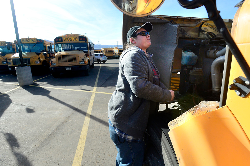 . BOULDER, CO - JANUARY 8, 2019 Driver Mellissa Gerard checks under the hood of her bus before starting her run at the BVSD Transportation Center Boulder Terminal on Tuesday afternoon January 8, 2019.  (Photo by Paul Aiken/Staff Photographer)