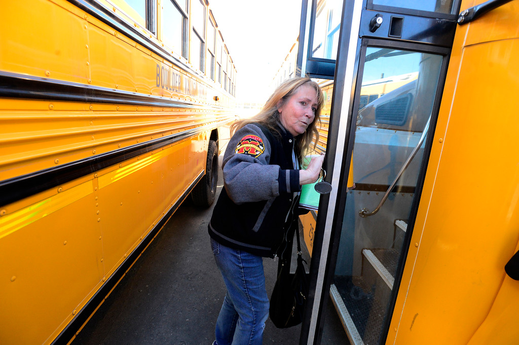 . BOULDER, CO - JANUARY 8, 2019 Driver Becky Bohnen checks out her bus prior to going on her route at the BVSD Transportation Center Boulder Terminal on Tuesday afternoon January 8, 2019.  (Photo by Paul Aiken/Staff Photographer)