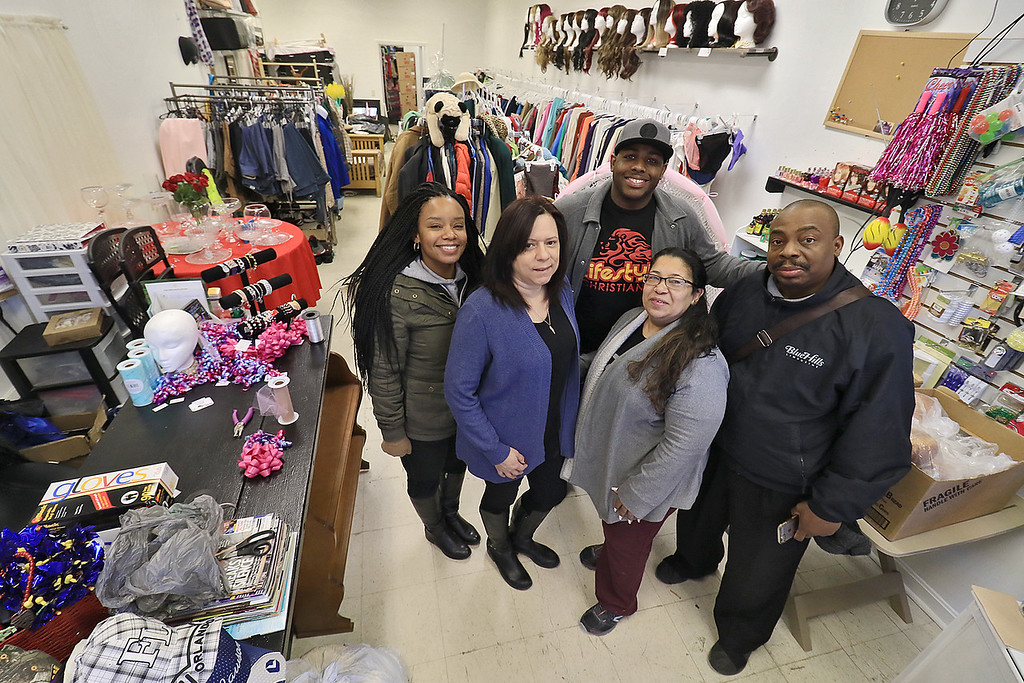 ". New Beginnings Ministry has taken over the shop next door to their church on Main Street in Fitchburg so that they could open up a shop they are calling ""Charity of Love\"" to help those in need.the get donated clothes and sell it for almost nothing to those in the area that need help. From left is, some of the people that help make this shop possible, Minister Angie Horeb, Minister Carmen Rios Benders, Minister Peter Wiggins Pastor Mayra Reyes Lee and Elder Michael Lee. SENTINEL & ENTERPRISE/JOHN LOVE"
