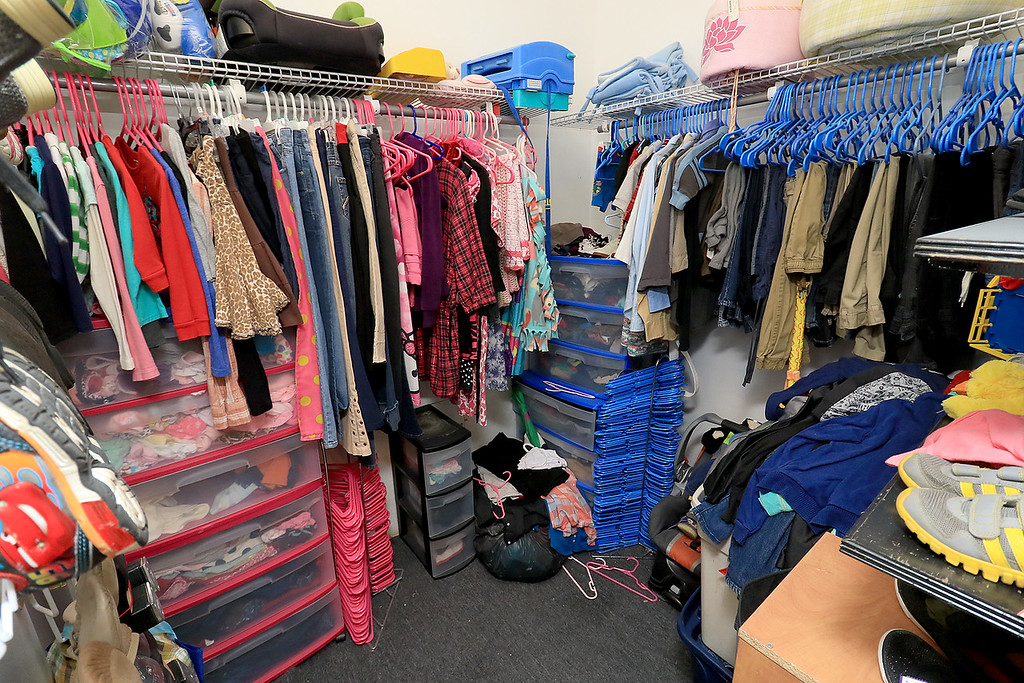 ". New Beginnings Ministry has taken over the shop next door to their church on Main Street in Fitchburg so that they could open up a shop they are calling ""Charity of Love\"" to help those in need.the get donated clothes and sell it for almost nothing to those in the area that need help.They have a room in the back of the shop just for children\'s clothes. SENTINEL & ENTERPRISE/JOHN LOVE"