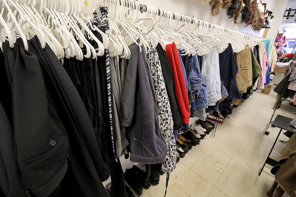". New Beginnings Ministry has taken over the shop next door to their church on Main Street in Fitchburg so that they could open up a shop they are calling ""Charity of Love\"" to help those in need.the get donated clothes and sell it for almost nothing to those in the area that need help. Some of the racks of clothes they have in stock. SENTINEL & ENTERPRISE/JOHN LOVE"