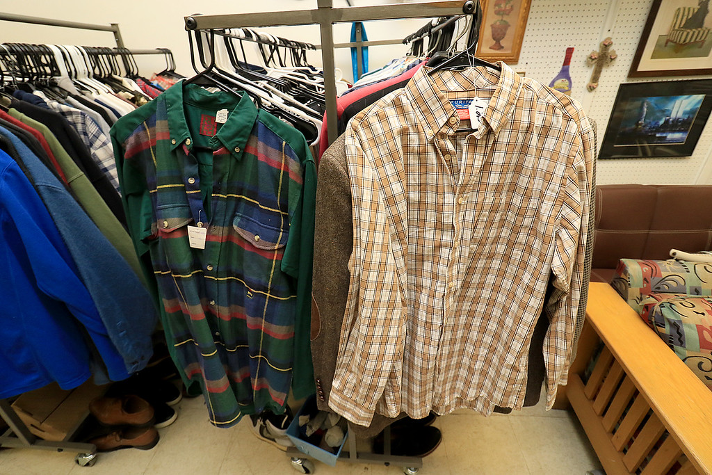 ". New Beginnings Ministry has taken over the shop next door to their church on Main Street in Fitchburg so that they could open up a shop they are calling ""Charity of Love\"" to help those in need.the get donated clothes and sell it for almost nothing to those in the area that need help. Some of the mens shirts they have for sale for $1.25. SENTINEL & ENTERPRISE/JOHN LOVE"