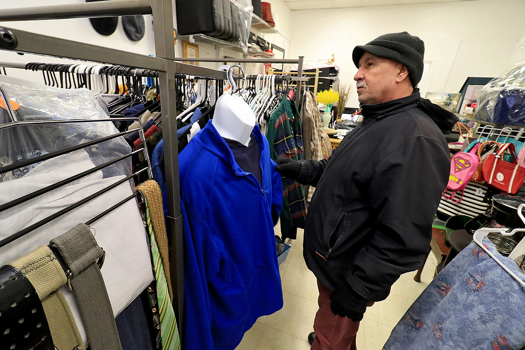 ". New Beginnings Ministry has taken over the shop next door to their church on Main Street in Fitchburg so that they could open up a shop they are calling ""Charity of Love\"" to help those in need.the get donated clothes and sell it for almost nothing to those in the area that need help. Luis Maldonado of Fitchburg looks over some of the stuff they had in the shop on Saturday, January 12, 2019. He comes in often to buy stuff he needs. SENTINEL & ENTERPRISE/JOHN LOVE"