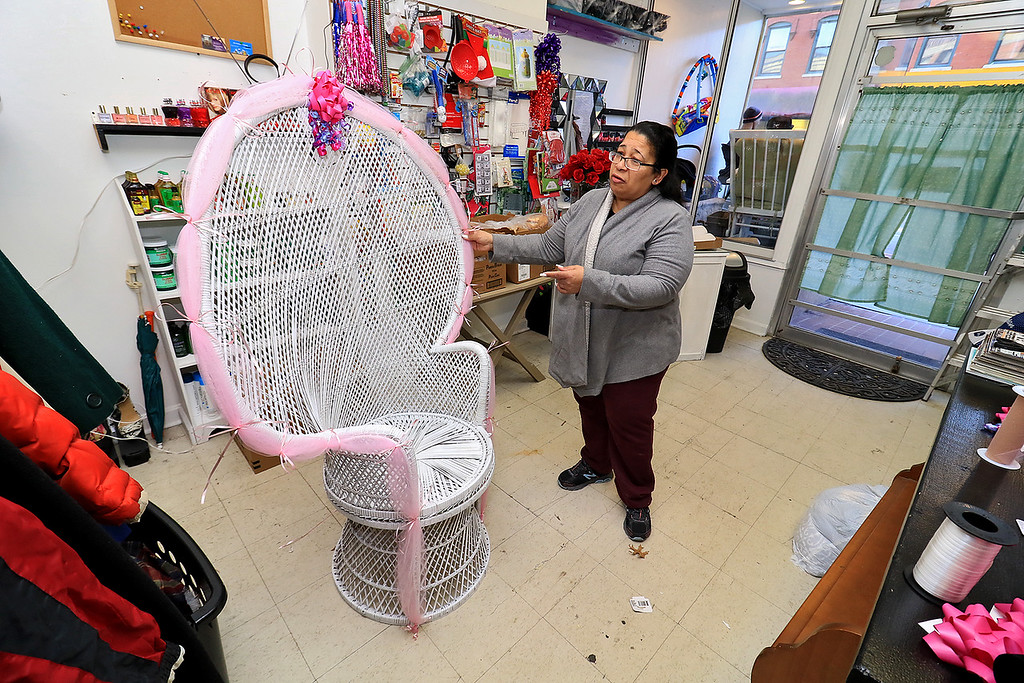 ". New Beginnings Ministry has taken over the shop next door to their church on Main Street in Fitchburg so that they could open up a shop they are calling ""Charity of Love\"" to help those in need.the get donated clothes and sell it for almost nothing to those in the area that need help. Paster Mayra Reyes Leee shows off a nice big chair they have in the shop that they rent out for $30 and that money goes to help buy food for their new food pantry. SENTINEL & ENTERPRISE/JOHN LOVE"