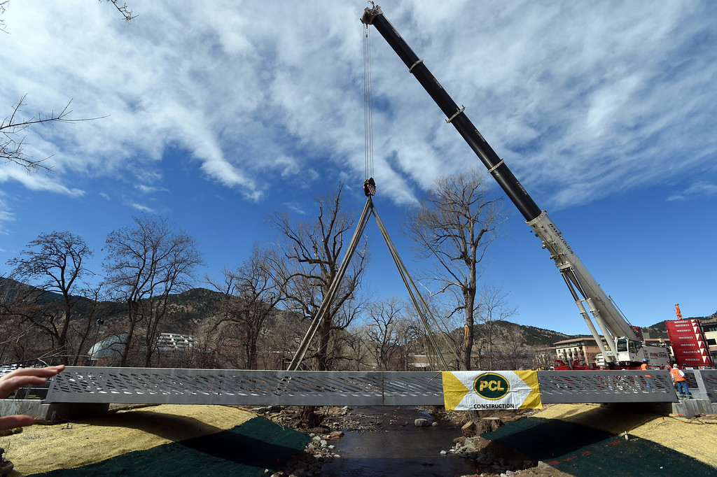 . A giant hydraulic crane moves the bridge into place.The large span of the new Civic Area Bridge in Boulder was set in place on Thursday over Boulder Creek next to the existing bridge that will be removed. For more photos and a video, go to www.dailycamera.com. Cliff Grassmick  Staff Photographer March 16, 2017