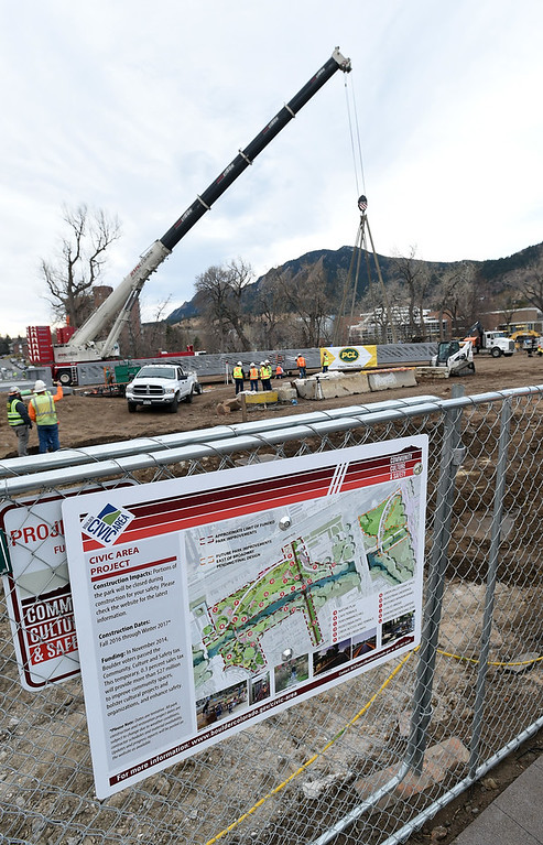 . The new bridge is pictured with the plans for the civic center in the foreground. The large span of the new Civic Area Bridge in Boulder was set in place on Thursday over Boulder Creek next to the existing bridge that will be removed. For more photos and a video, go to www.dailycamera.com. Cliff Grassmick  Staff Photographer March 16, 2017