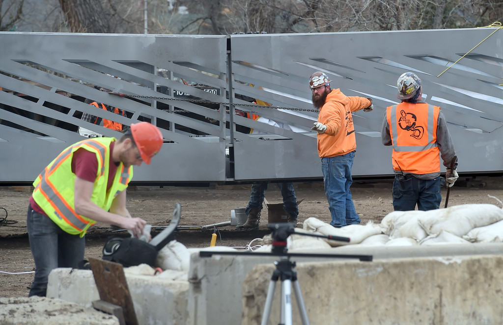 . Workers connect the two sections of the new bridge. The large span of the new Civic Area Bridge in Boulder was set in place on Thursday over Boulder Creek next to the existing bridge that will be removed. For more photos and a video, go to www.dailycamera.com. Cliff Grassmick  Staff Photographer March 16, 2017