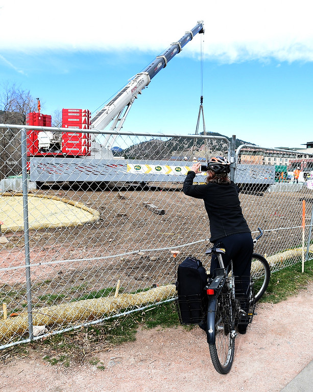 . Boulder mayor, Suzanne Jones, stops to take a photo of the new bridge. The large span of the new Civic Area Bridge in Boulder was set in place on Thursday over Boulder Creek next to the existing bridge that will be removed. For more photos and a video, go to www.dailycamera.com. Cliff Grassmick  Staff Photographer March 16, 2017