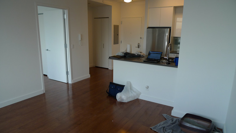 Living room looking at kitchen and entrance