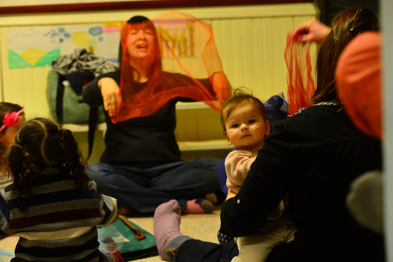 "KRISTOPHER RADDER - BRATTLEBORO REFORMER<br /> Josephine Gilbert, 9-months, smiles while being held by her mother during the program put on by Robin Morgan called "" Sing and Dance with Robin"" at KidsPLAYce on Tuesday, Feb. 6, 2018. The program runs every Tuesday until the first Tuesday in April."