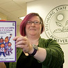 Dani Langdon the Fitchburg State University Assistant Director of the Center for Professional Studies shows off the book she will be using in her new class Supporting LGBTQIA and gender Diverse Students in K-12 Environment. SENTINEL & ENTERPRISE/JOHN LOVE