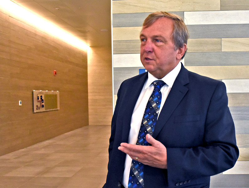 Atty Robert W. Normandin gives his thoughts on the opening of the new Judicial Center, having worked for many years in the older courthouses. SUN/ David H. Brow