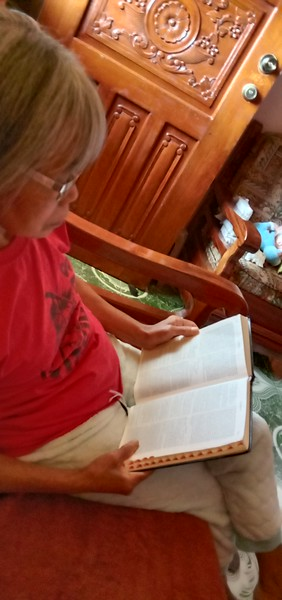 my wife studying the Bible. she reads it daily