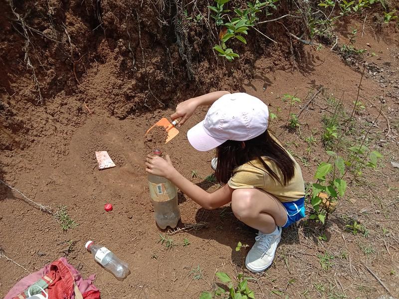 Chin Chin helping with saving soil