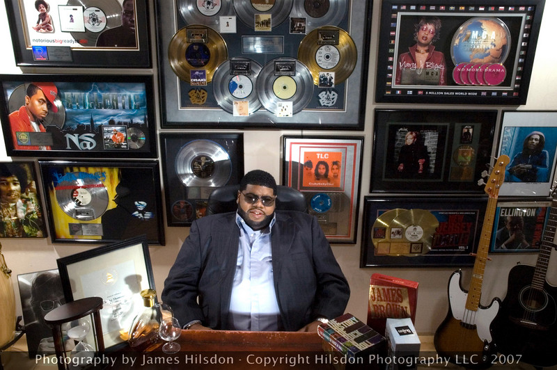 Chucky Thompson relaxing in his office at LifePrint Productions in Washington, D.C. <br /> <br /> His many years of multi-platinum success are highlighted on the wall behind him....<br /> <br /> OVER 50 MILLION COPIES SOLD... AND COUNTING!  This man is responsible for some of the best music in the last 15 years. Period.
