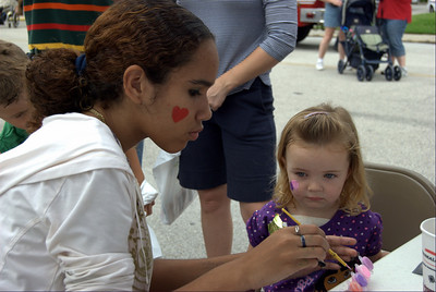 Youth group face painting at Haines city festival