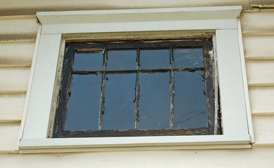 Window in front gable, glazing failed, paint failure, but window was still repairable.