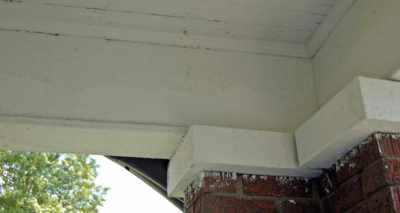 Another shot of porch paint failure and uneven previous paint job.