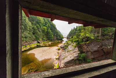 A view of Point Wolfe from the window of a covered bridge.  Fundy National Park.  New Brunswick, Canada.