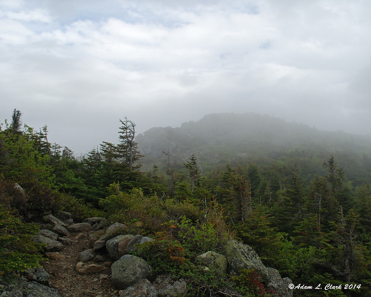 Clouds trying to clear looking back at Bigelow Mountain Avery Peak
