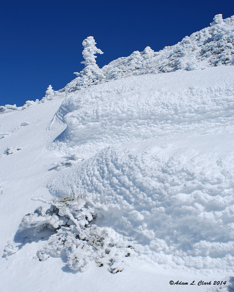 A combination of ice, snow, and rime cover everything near the summit